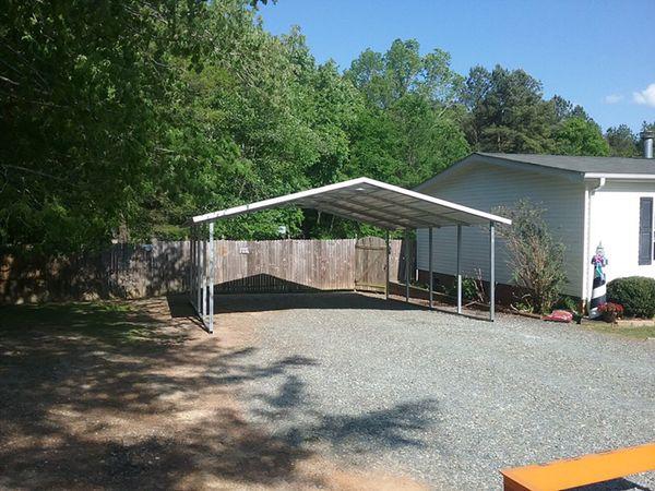 carport in gravel driveway